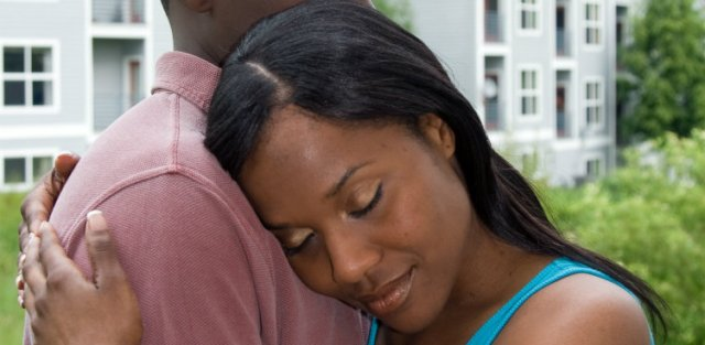 black couple woman resting head on mans shoulder 751